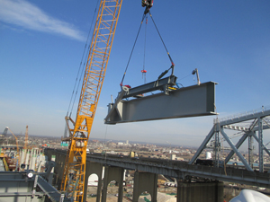 Beam lifted with crane using hydraulic manipulator